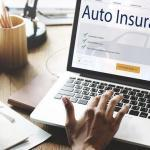 woman on laptop researching auto insurance, specialized, high-risk auto policies