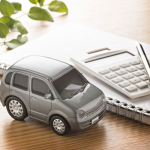 toy car next to a calculator, nonowner FR44 insurance