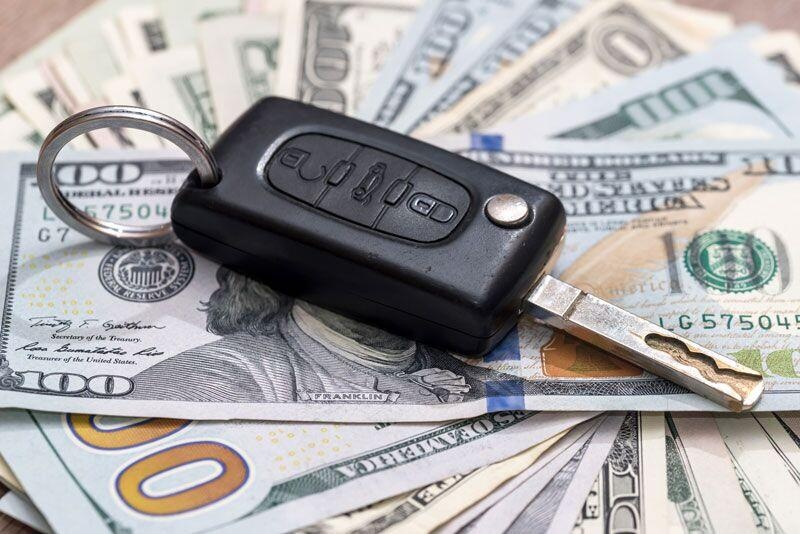 car key with money, reducing your car insurance rates after a DUI